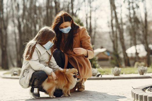family with a pomeranian dog